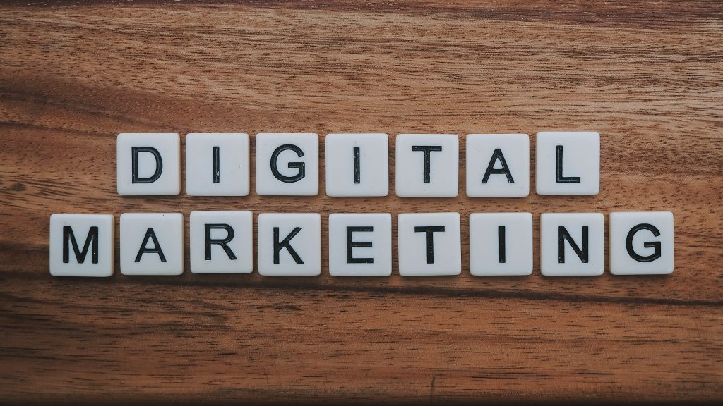 The picture displays digital marketing in scrabble tiles - part of the title of the blog